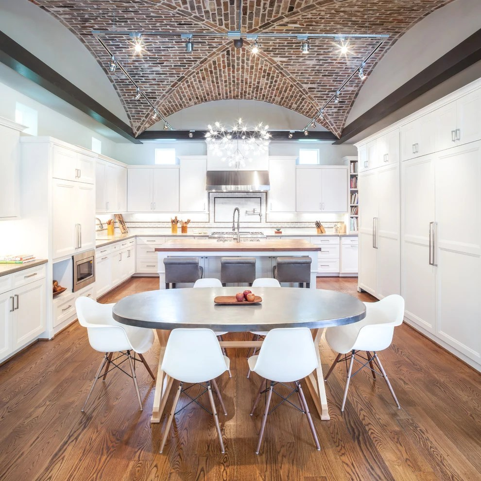 Winter White Wall Lined With Cabinets Paired A Grey Dining Table And