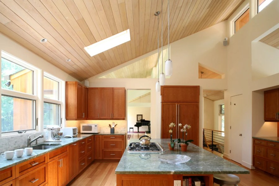 42 Kitchens With Vaulted Ceilings   Home Stratosphere The slant in the roofing make this room feel larger than it is