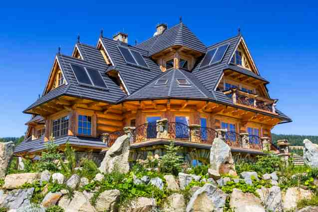 Grand log home mansion with huge deck and skylights throughout with incredible views of valley.