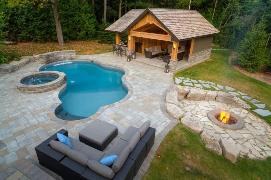 25 Swimming Pools with Cabanas (Photos) - Home Stratosphere on Small Pool Cabana Ideas id=83300