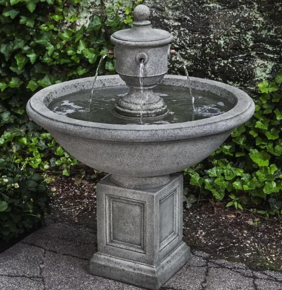 A self-contained fountain made out of concrete.