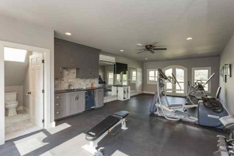 44 Home Gym Design Ideas for 2018 There s a home gym too  complete with necessary fitness equipment and a TV  lighted by recessed lights