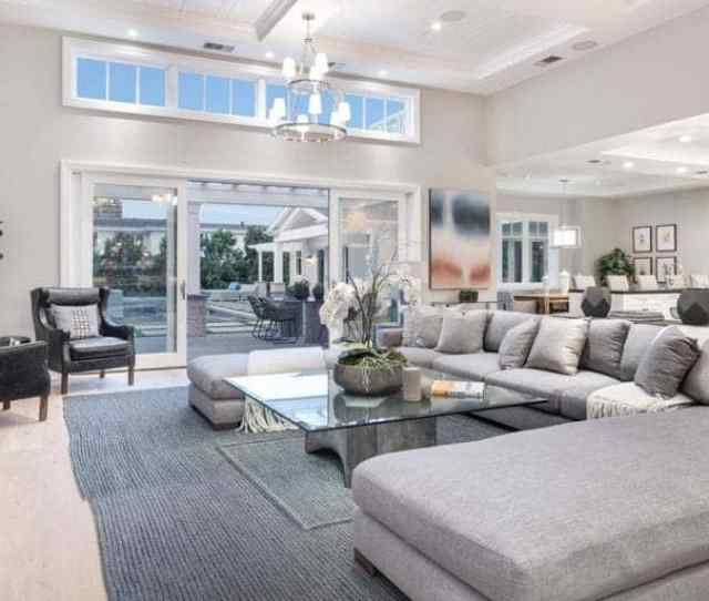 The Living Room Features Modern Furniture Set Along With A Stylish Rug And Ceiling Light
