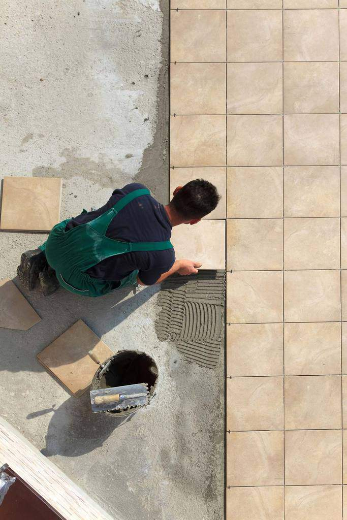 laying a ceramic tile floor hometips