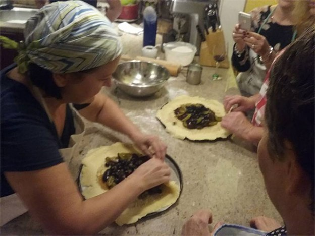 Paola Scatozza teaching her cooking class.