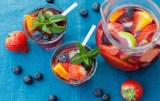 Refreshing sangria (punch) with fruits and berries ** Note: Shallow depth of field