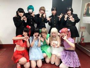 Japanese idol metal darkwave black metal idol group Necronomidol posing with Japanese idolcore yami-kawaii idol group Zenbu Kimi no Sei Da