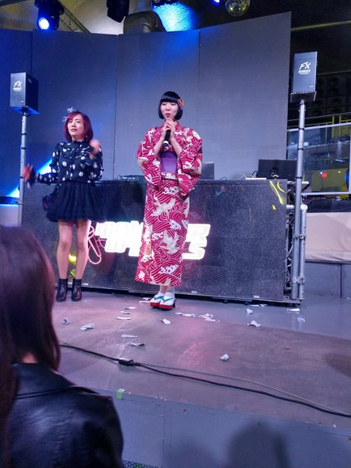 Monster of Dolls MC Eriko and Sari on stage.