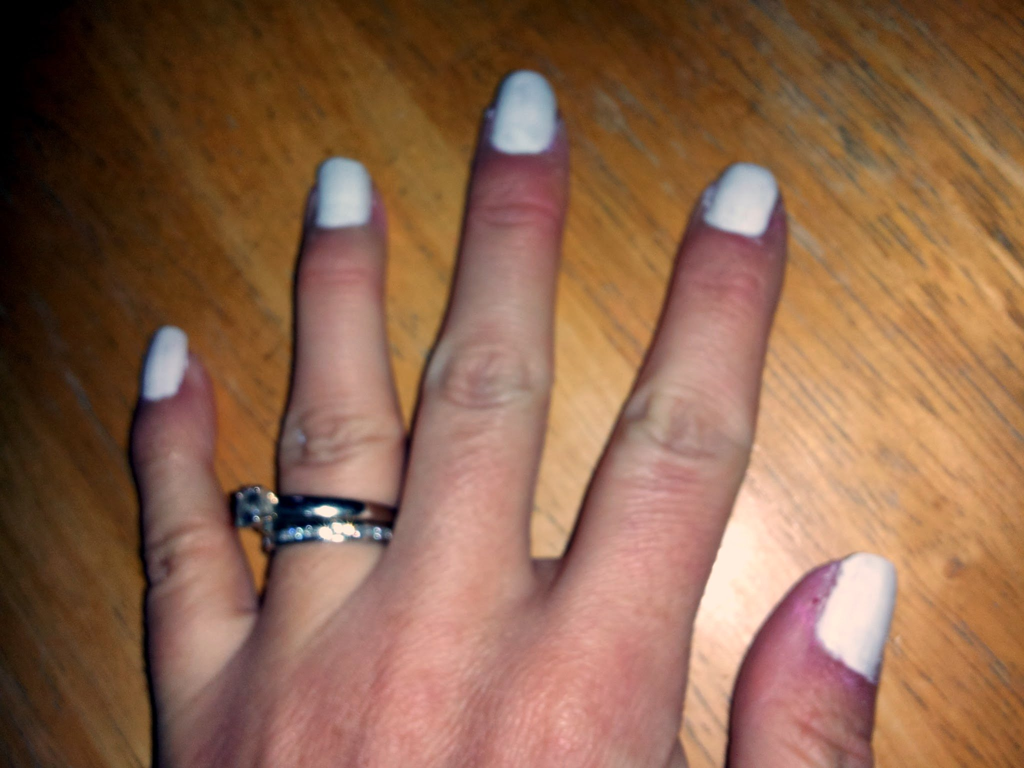 Nails with two coats of white polish