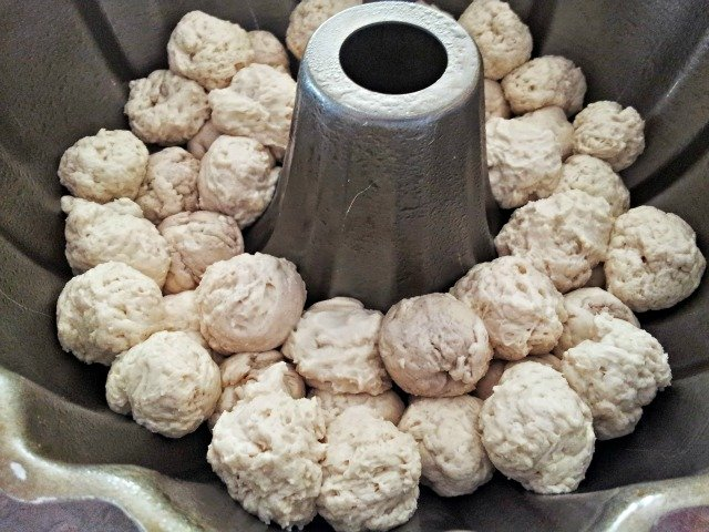 Simply rolls walnut size pieces of dough and place them in a greased bundt pan