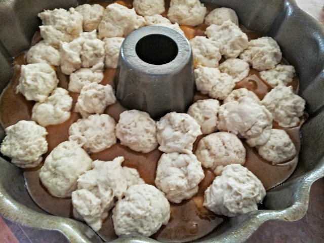 Roll the rest of the dough into balls and place into the bundt pan.  It's ok if they don't cover the sauce or fill the pan
