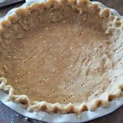 Prick the pie crust with a fork before baking
