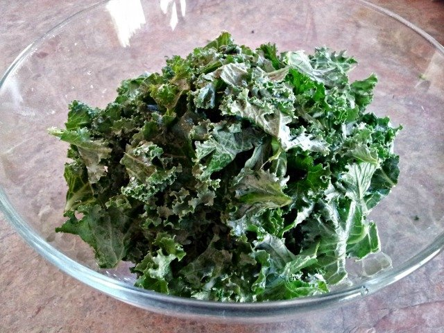 Kale in a bowl ready to dress for kale salad
