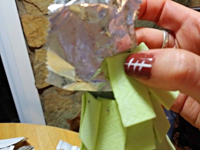Attaching the gum top using wrappers as wrapping paper