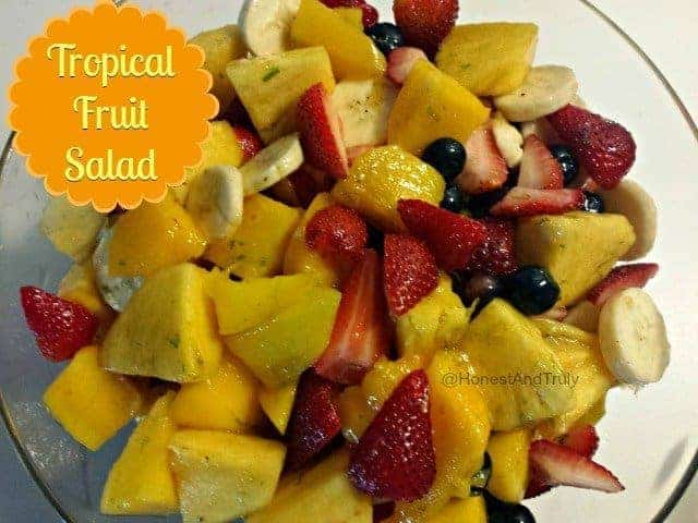 Tropical fruit salad is made all the better with a little glaze that wakes up the salad and makes it come together. An easy recipe that will make you the hero of any gathering