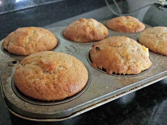 Perfectly baked peach kuchen muffins