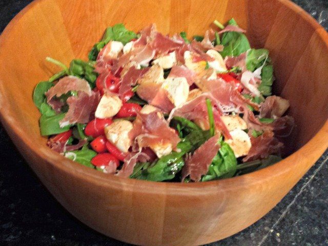 Spinach caprese salad ready to enjoy with all ingredients