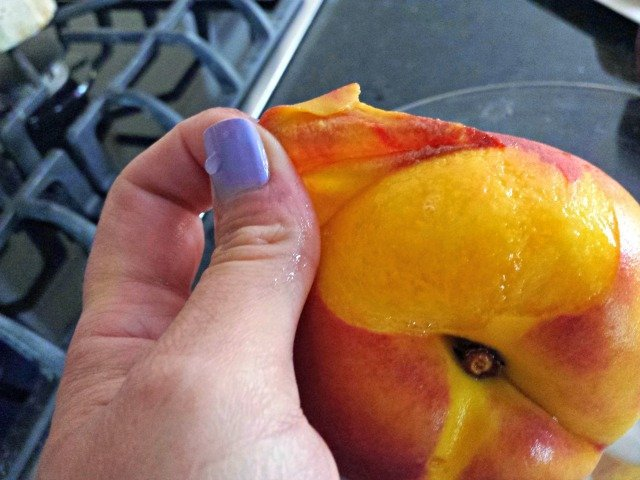 Easily peel the skin off your peach by hand