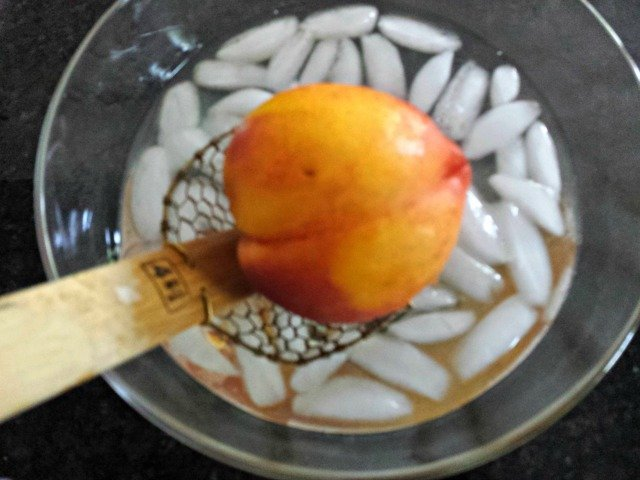 Add blanched peach to your ice bath