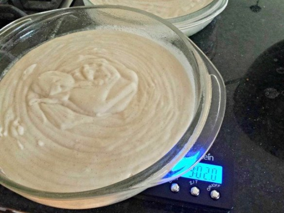 Divide your cake batter equally into  pans using a kitchen scale