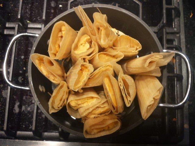 Cook tamales be steaming