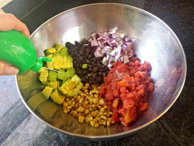 Adding lime juice to black bean and corn salsa
