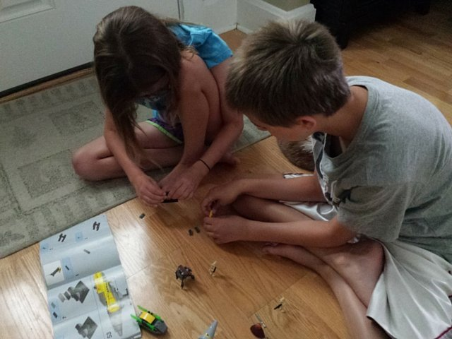 Working together to build Star Wars Naboo Starfighter