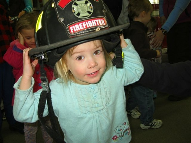Trying on the firefighter hat