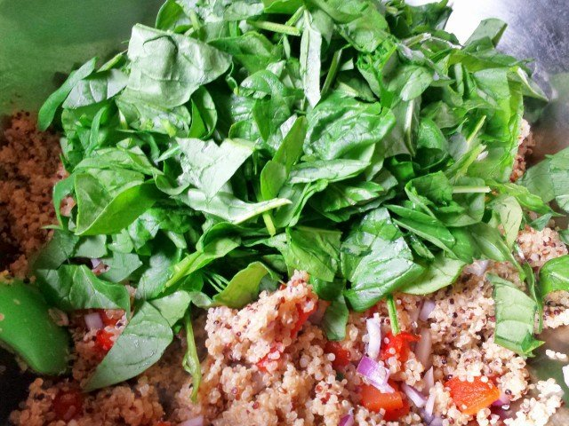 Add chopped spinach to quinoa and veggies