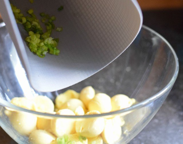 Add chopped green onion to egg yolks for bacon deviled eggs