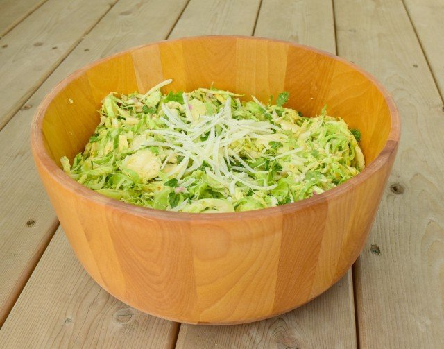 Bowl of shaved Brussels Sprouts salad with Parmesan