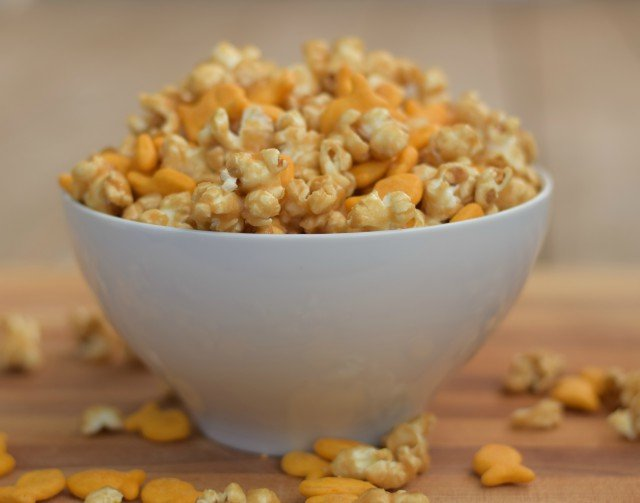 Enjoy a bite of cheesy caramel corn