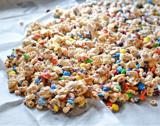 Spread white chocolate party mix on wax paper to harden