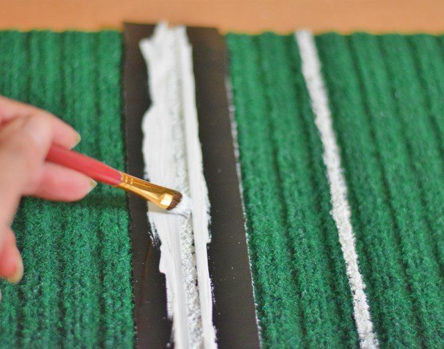 Paint yard markers on green mat