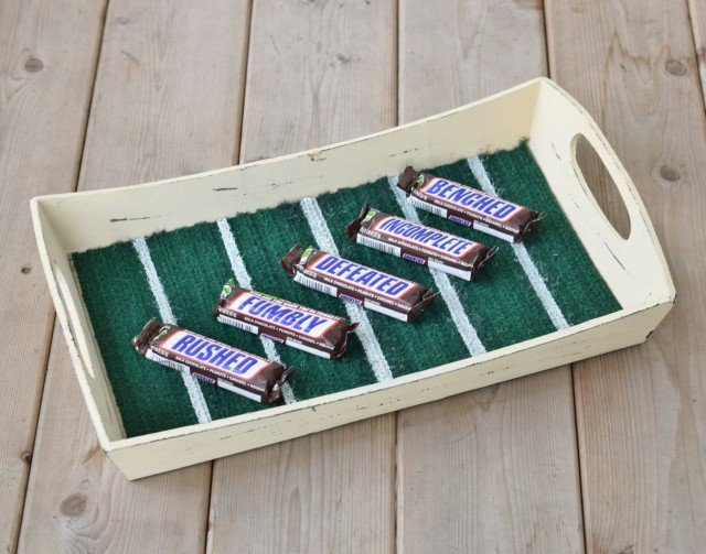 Snickers on a DIY football serving tray