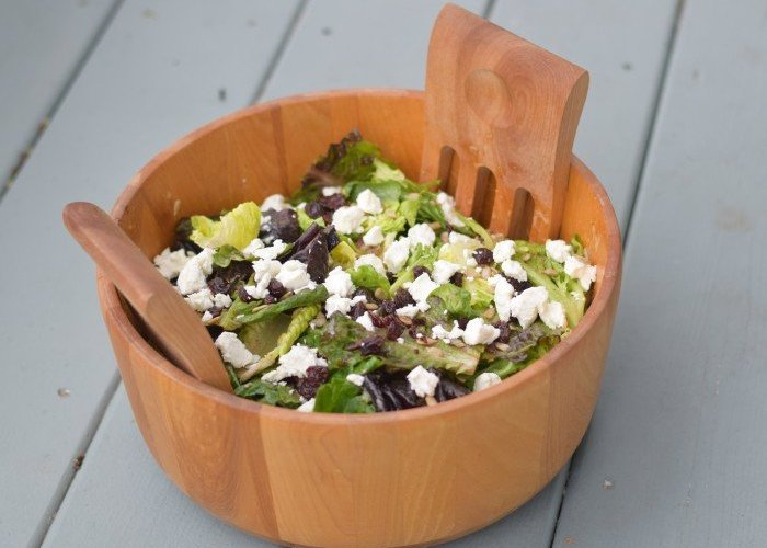 Bowl of cherry goat cheese salad with a homemade red wine vinaigrette