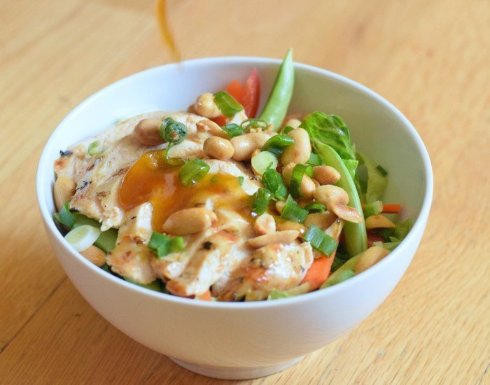 Bowl of homemade kung pao chicken salad with PF changs sauce