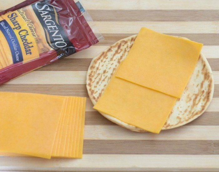 Add cheese to your cold chicken taco wraps