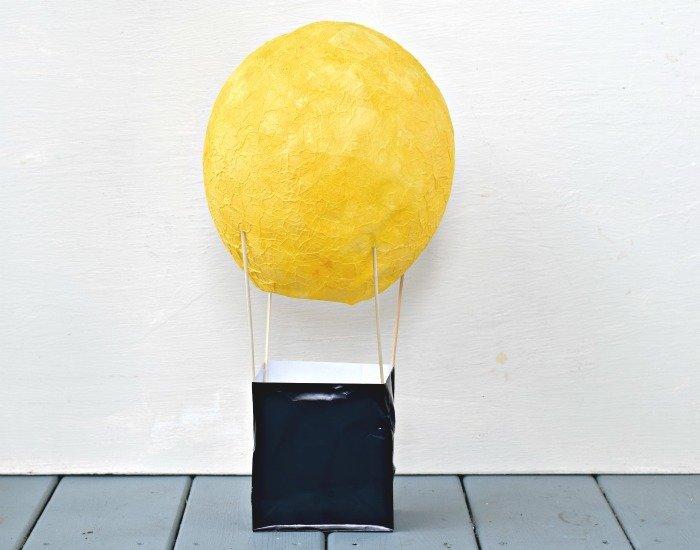 DIY hot air balloon centerpiece partially assembled