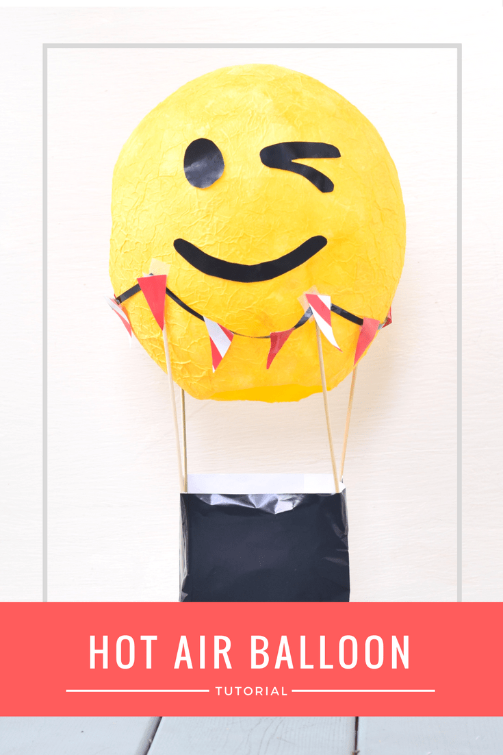 Make this fun paper mache DIY hot air balloon centerpiece for your next emoji kids birthday party. This tutorial shows you how to make this emoji hot air balloon for a fun centerpiece or to hold cards so they don't get lost.