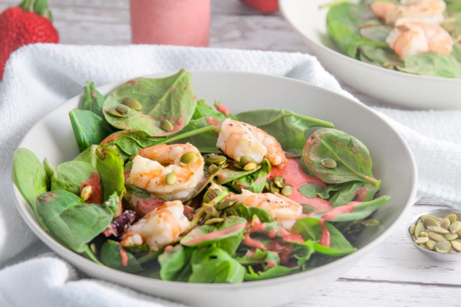 summer shrimp salad with strawberry mint algae oil dressing close-up