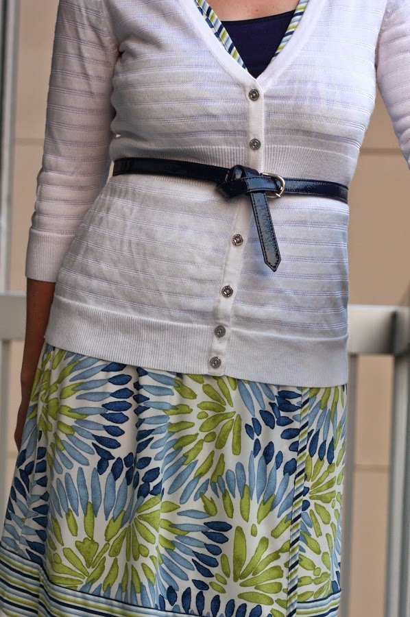 white cardigan, blue and green floral wrap dress, navy belt