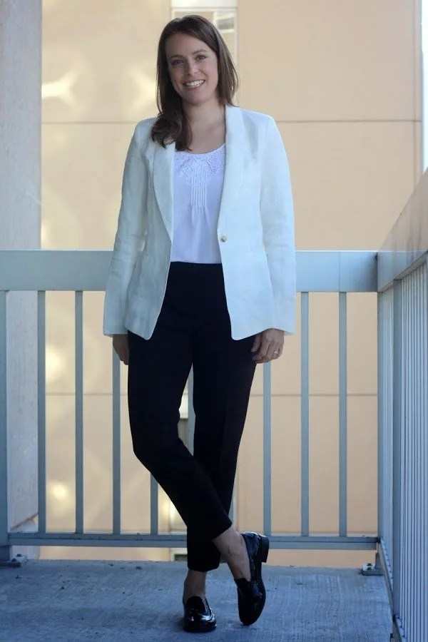 white Marine Layer blazer, black Theory pants, black women's flats