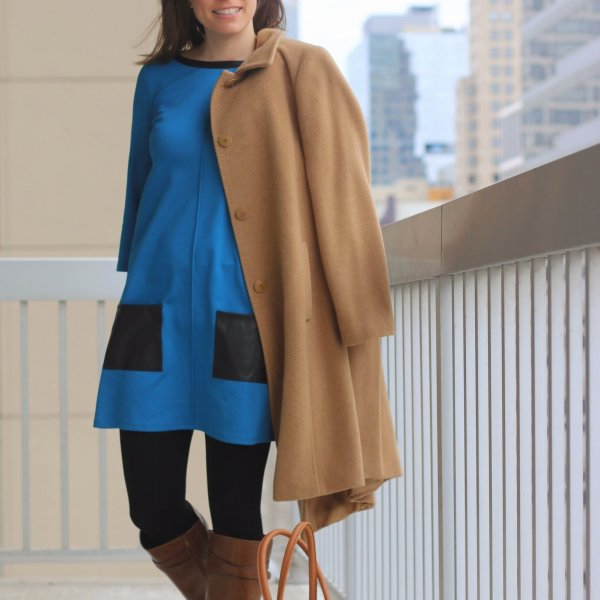 FashionablyEmployed.com | Camel hair coat, blue mod dress with leather details, tights, and cognac boots | wear to work, office | style blogger, winter style