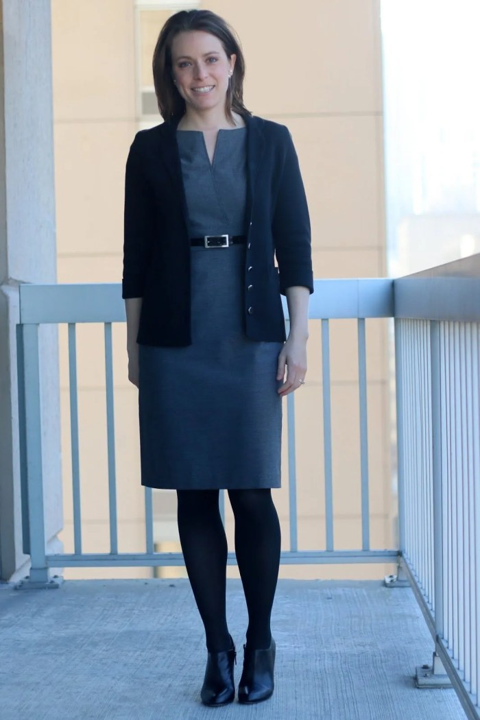 FashionablyEmployed.com | Gray thrifted dress with black cardigan and belt, black tights and booties, green tote bag | wear to work, office style