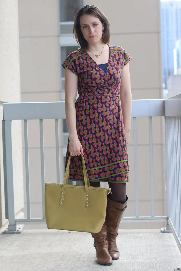 FashionablyEmployed.com | pink and green geometric print wrap dress with cognac boots and bright green bag | women's work wear style, office outfit, business casual