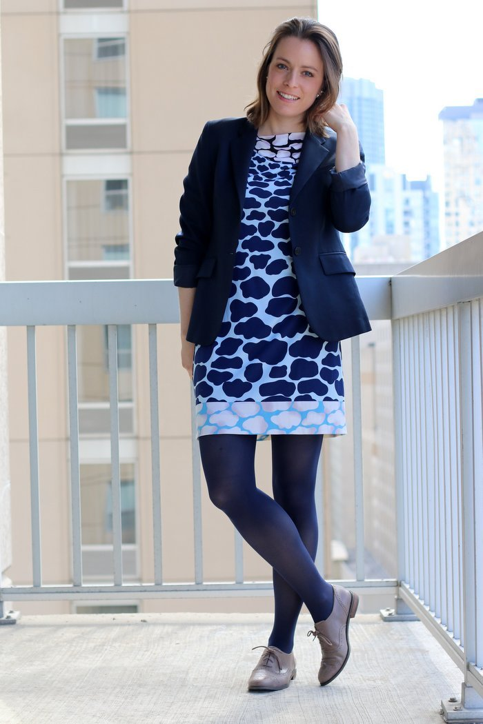FashionablyEmployed.com | Giraffe print shift dress with navy blazer, navy tights and gray oxfords, women's business casual work outfit, style blog for working moms