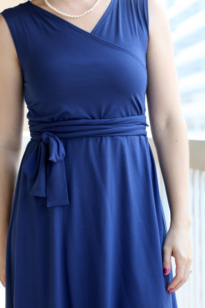 FashionablyEmployed.com | Wrap dresses can be deceiving difficult to wear in a conservative office setting. Check out this new style that solves all the wrap dress dilemmas!
