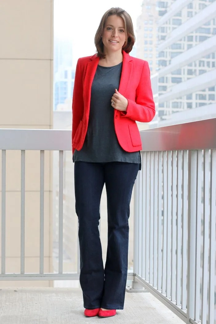 FashionablyEmployed.com | Simple and sustainable work wear style for the everyday professional woman | Seventies style is back; Flared jeans at the office for casual Friday | Poppy thrifted blazer, gray tank, thrifted flared jeans, red heels | fall style wear to work, office outfit idea