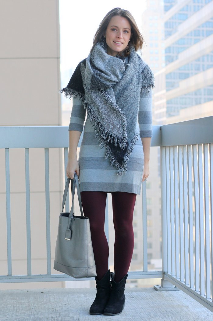 FashionablyEmployed.com | Winter layers: striped sweater dress, blanket scarf, maroon tights and black ankle boots, warm layers for a cozy day at the desk | Simple and sustainable style for everyday professional women | wear to work, office style, workwear